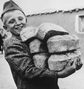 Boy with Loaves of Bread